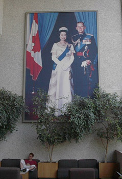 A large portrait of , with , hanging in a Canadian courthouse. Queen Elizabeth is a multiple head of state, and is Queen of , , ,  , the , and eleven  (1952-present)