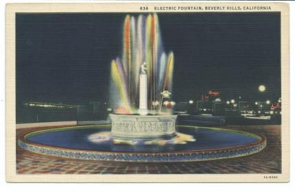 Fountain with colored lights at intersection of Wilshire Blvd. and Santa Monica Blvd. in Beverly Hills, California