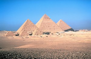 The . The largest pyramids, from left to right, are Menkaure's pyramid, Khafre's pyramid, and the Great Pyramid.