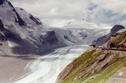 Austria's longest glacier, the Pasterze, winds its 8 km (5 mile) route at the foot of Austria's highest mountain, the .