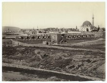 The Old City of Akko in the 19th or early 20th century, looking south-west from atop the Land Wall Promenade, the open space now a parking lot. Al Jazzar Mosque in the foreground. See also Map (http://www.akko.org.il/English/Map/default.asp)