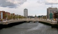 Dublin's Ha'penny Bridge. Beyond it, the dome of the   and , the city's tallest building.
