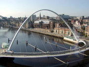 The tilting Gateshead Millennium Bridge from the Baltic Art Gallery