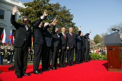 The U.S. President, NATO Secretary General, and the Prime Ministers of Slovenia, Lithuania, Slovakia, Romania, Bulgaria, and Estonia after a South Lawn ceremony welcoming them into NATO on March 29, 2004.