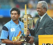 handing over the Man of Tournament trophy to Sachin Tendulkar at the 2003 World Cup