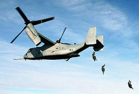 U.S. Marines jump from an Osprey.